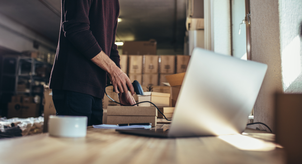 Ecommerce Marketer Scanning A Box for Shipping